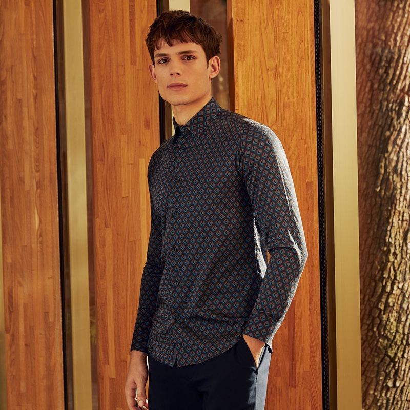 Making a graphic statement, Adrian Sotiris wears Ted Baker's Glacee geo print shirt $165.