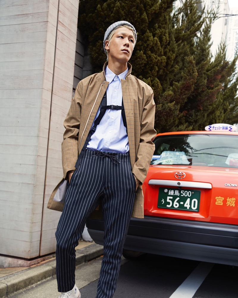 Front and center, Jumpei rocks a Todd Snyder + Descente allterrain collar coat $950 and navy pinstripe long pants $320.