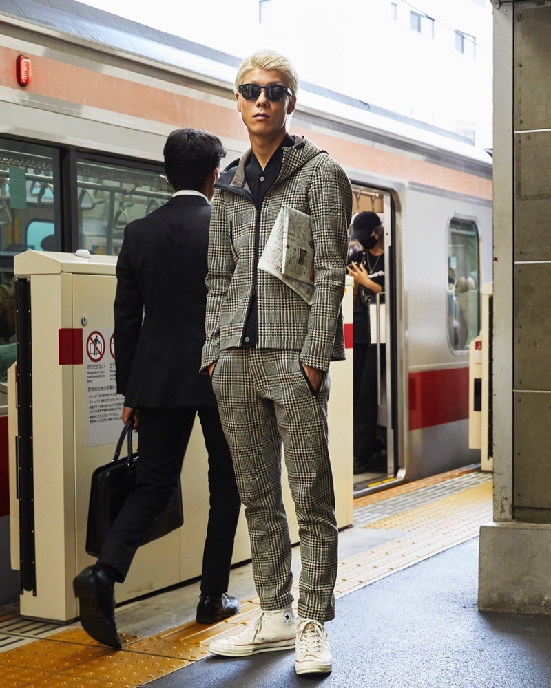 On the move, Jumpei sports a Todd Snyder + Descente hoodie jacket $370 and long pants $320 in glen plaid.