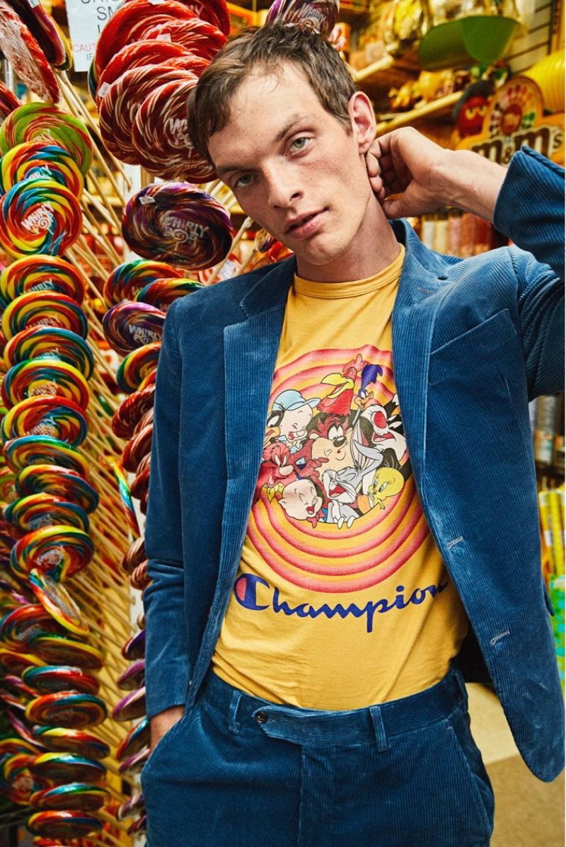 Embracing a pop of color, Rocky Harwood wears a Todd Snyder + Champion + Looney Tunes gang tee $88 in warm gold.