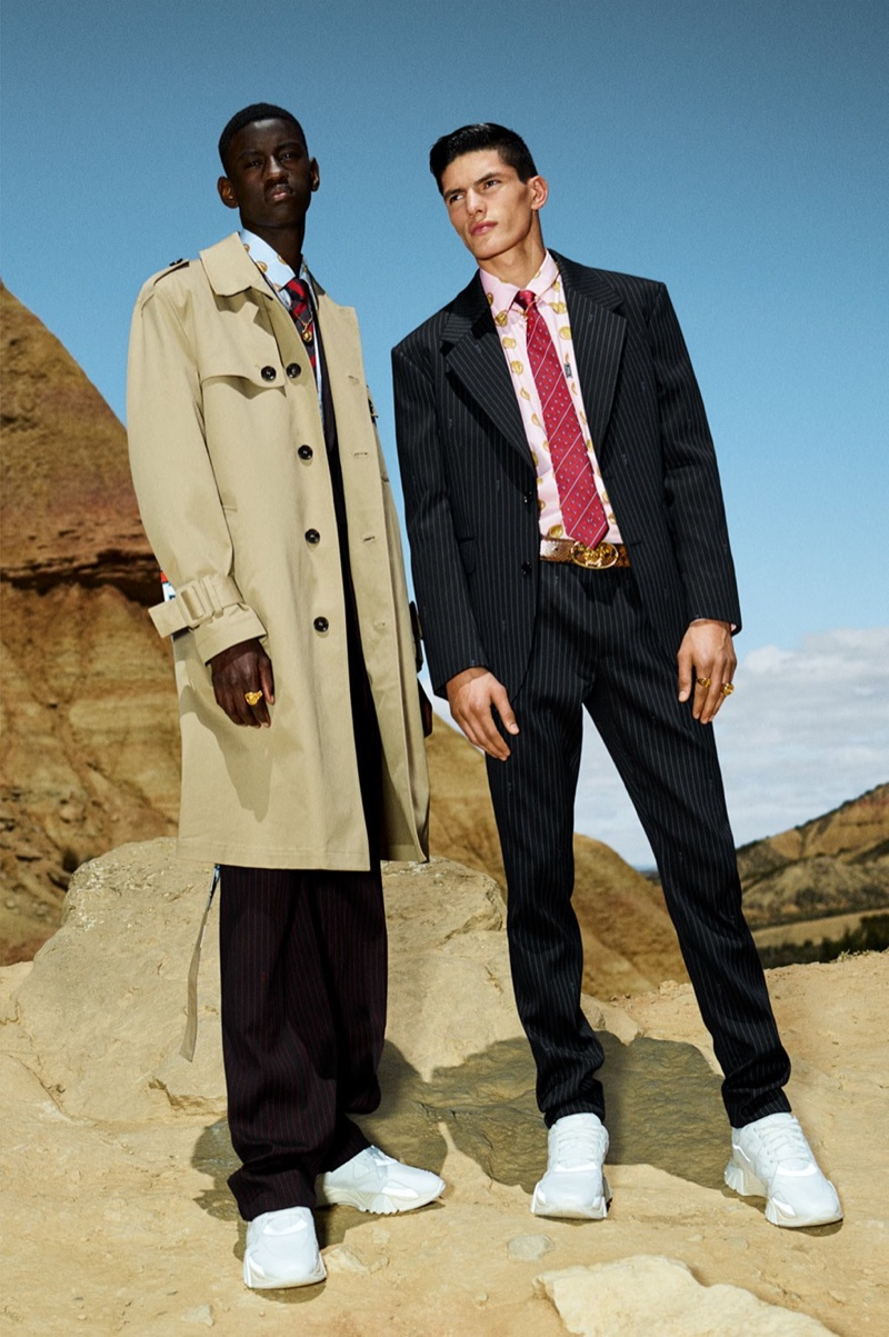 Models Soulemane Tounkara and Islam Dulatov wear relaxed tailoring from Versace's cruise 2020 collection.