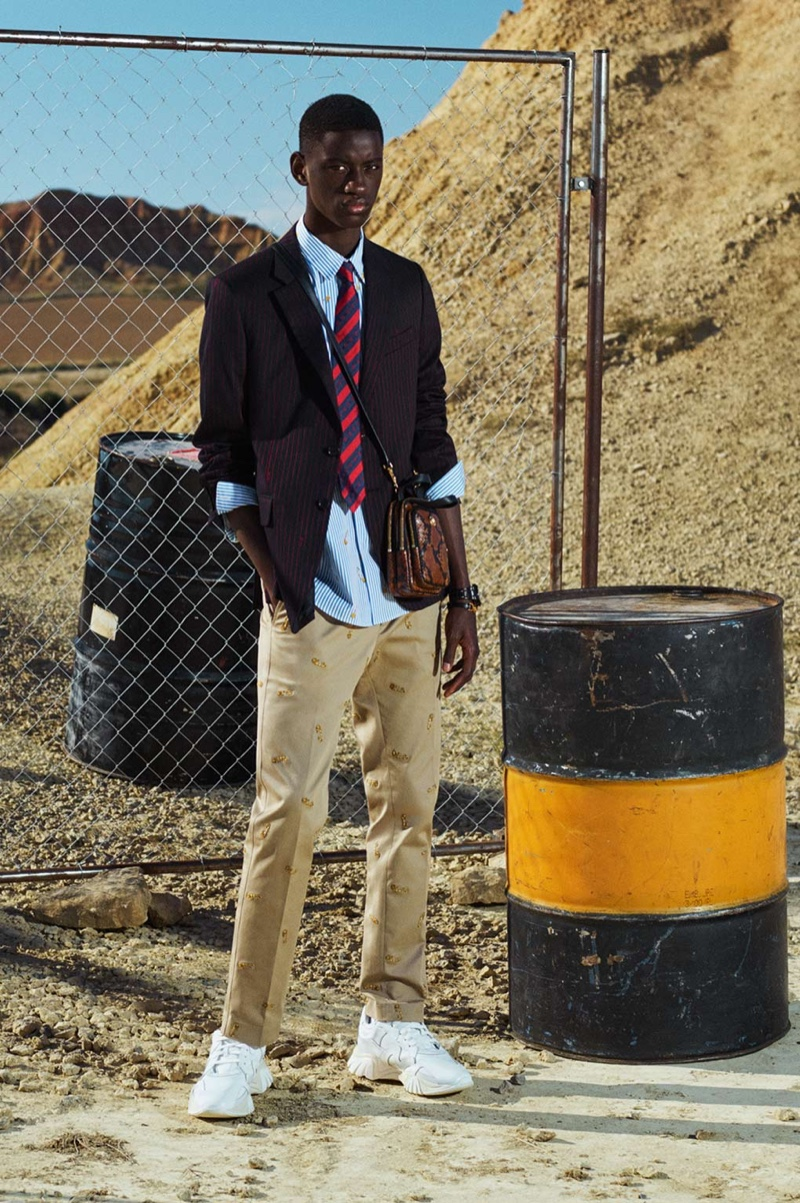 Embracing preppy style, Soulemane Tounkara showcases smart pieces from Versace's cruise 2020 collection.