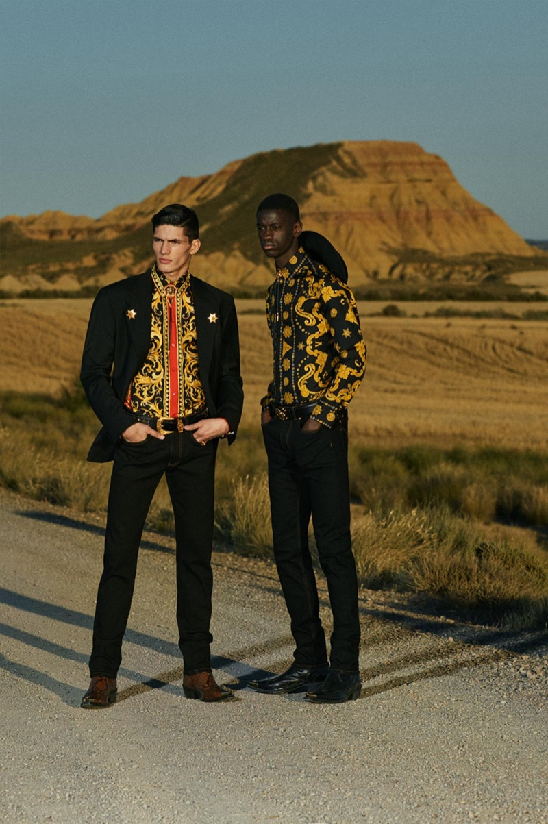 Connecting with Versace for its cruise 2020 collection, models Islam Dulatov and Soulemane Tounkara embrace western-inspired style.