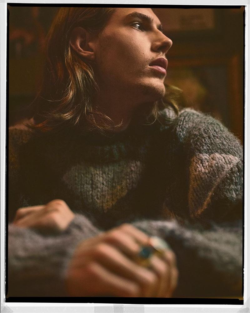 A cozy vision, Niclas Koch models Zara knitwear for the season.