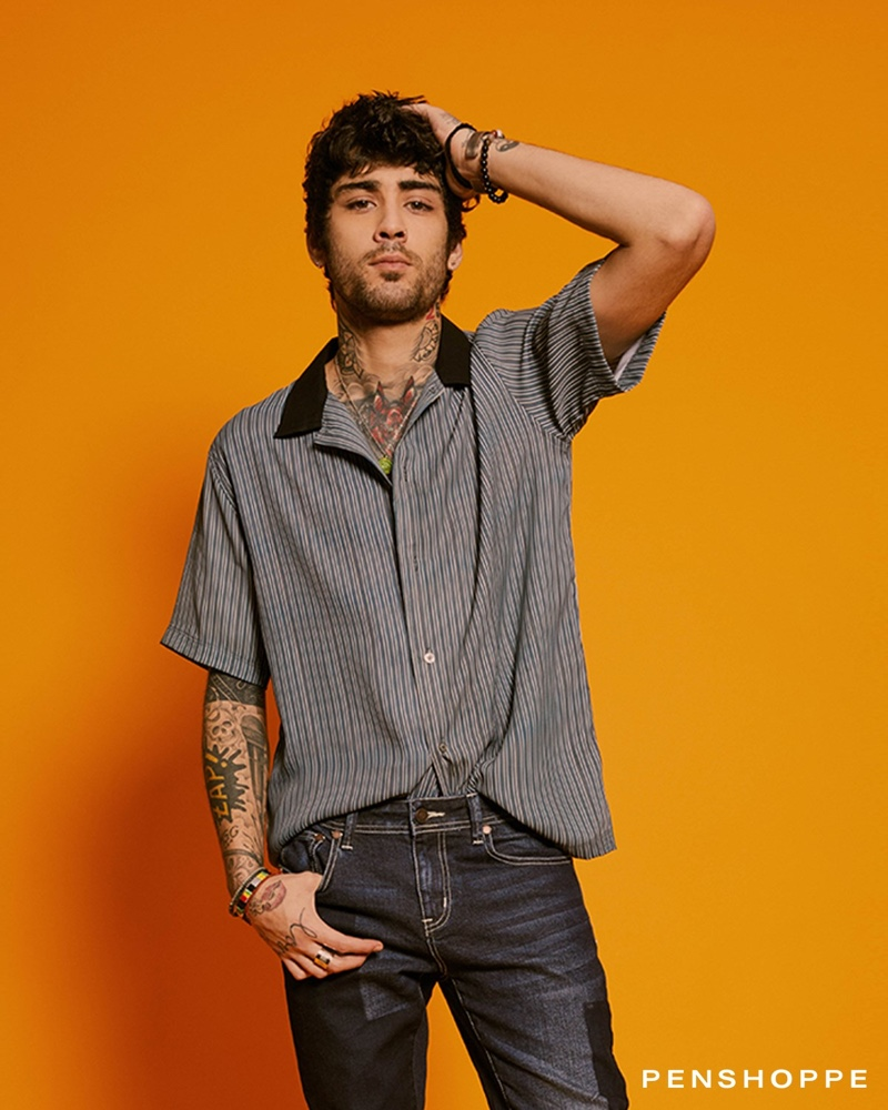 Front and center, Zayn Malik sports a retro-inspired short-sleeve shirts with denim from Penshoppe.