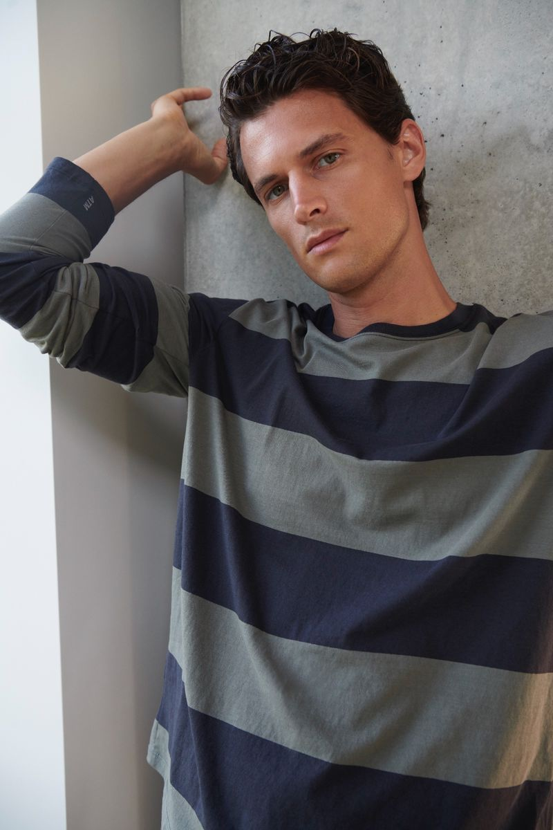 Embracing essential style, Garrett Neff wears a striped long-sleeve tee by ATM.