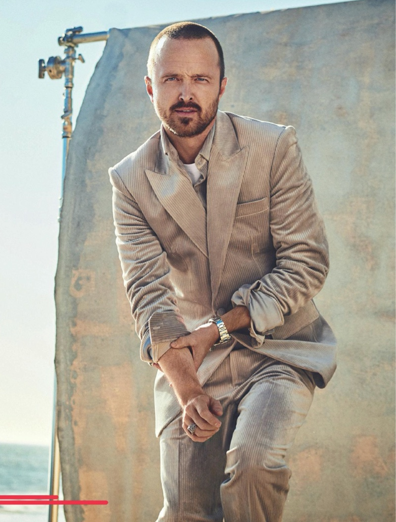 Front and center, Aaron Paul wears a Dzojchen shirt and suit with a Dunhill t-shirt for Men's Journal.