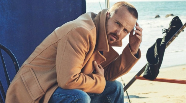 Starring in a photo shoot for Men's Journal, Aaron Paul sports a Mr P. coat, The Workers Club Denim Jeans, and Kenneth Cole boots.