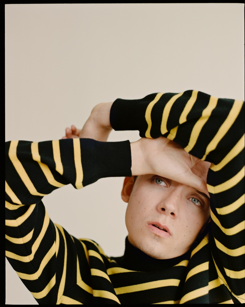 Donning a striped sweater by Stella McCartney, Asa Butterfield stars in a shoot for The Laterals.