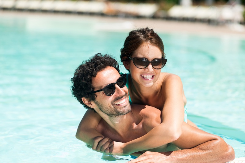 Attractive Couple Pool Sunglasses Smiling