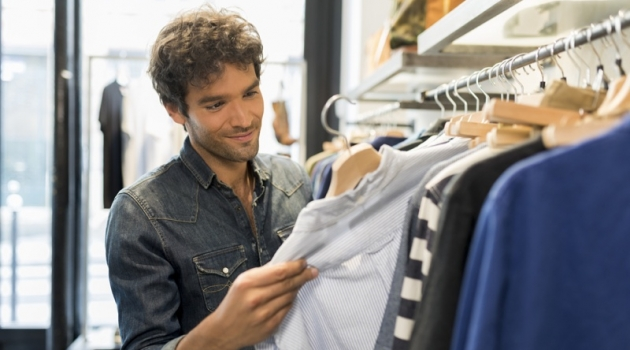 Attractive Hispanic Man Shopping Clothes