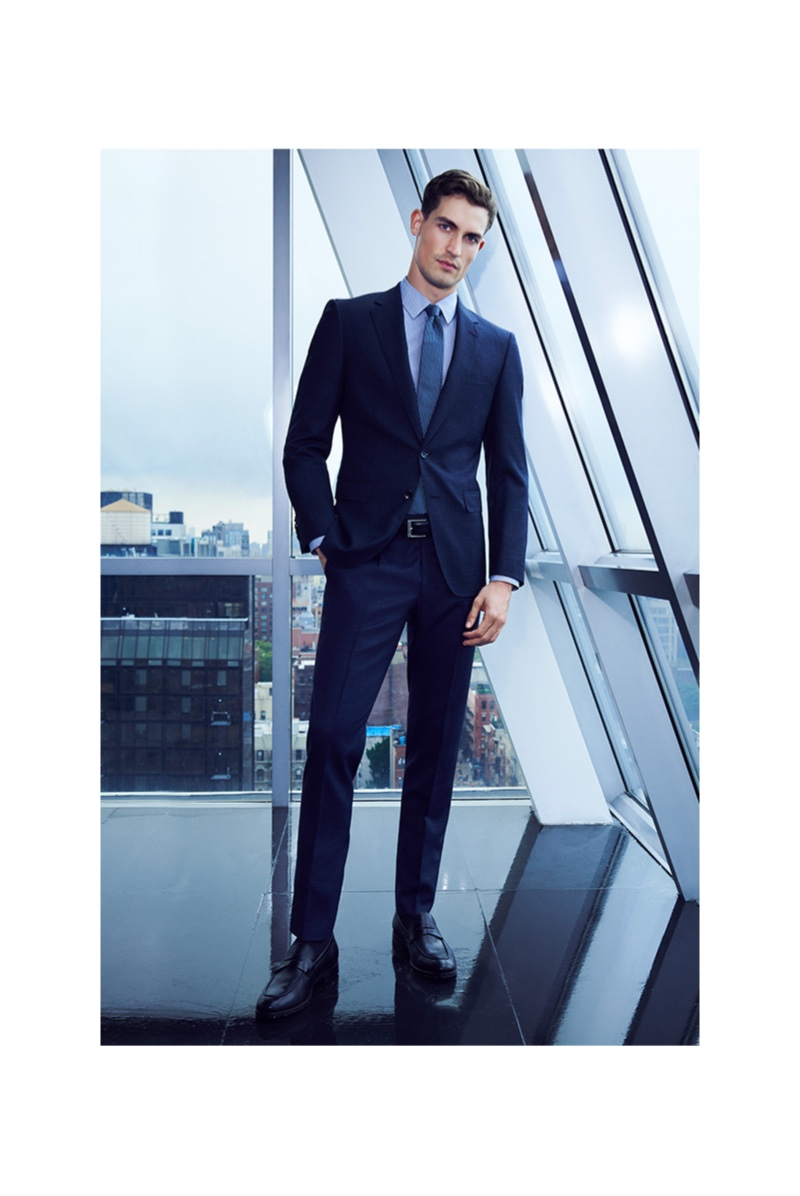 Front and center, Jason Anthony cleans up in a sleek navy BOSS suit for Bloomingdale's.