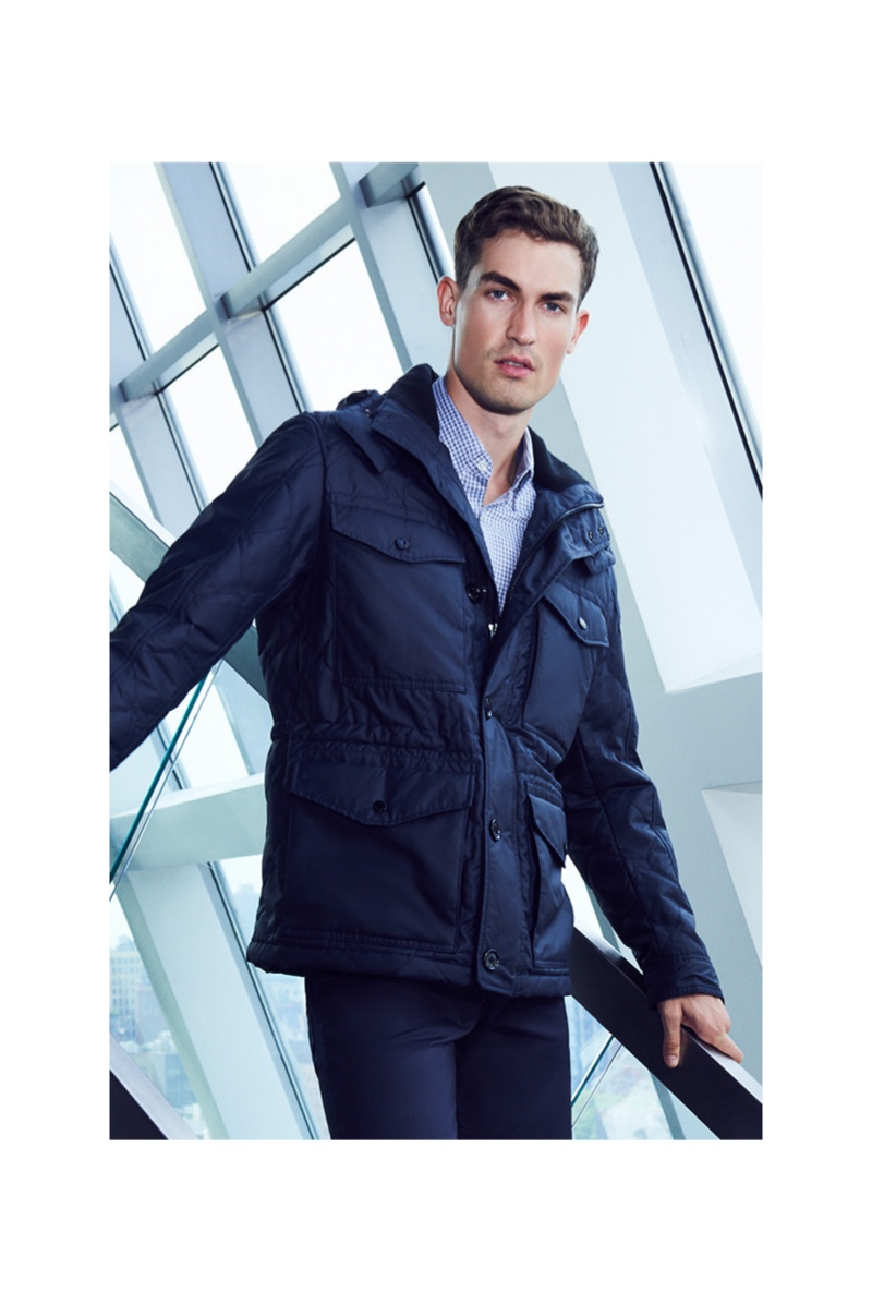 Model Jason Anthony goes semi-casual in a navy look from BOSS for Bloomingdale's.