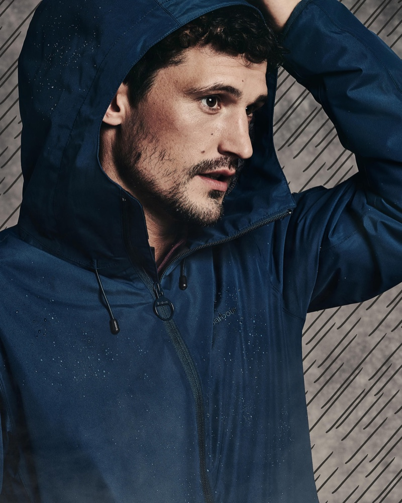 British model Sam Webb sports a hooded jacket by Barbour.