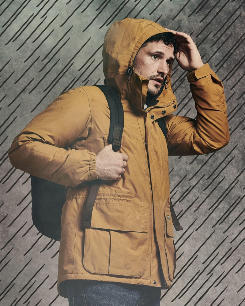 Front and center, Sam Webb keeps warm in a hooded jacket by Barbour.