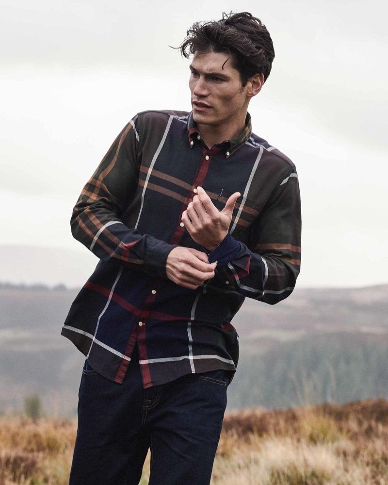 Taking to the outdoors, Sam Way dons a plaid shirt from Barbour's latest men's collection.