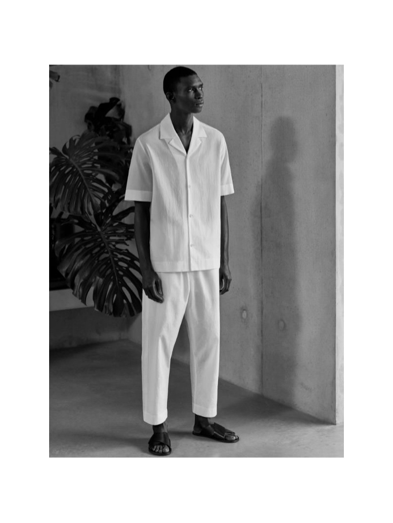 Taking to the studio, Fernando Cabral wears a COS short sleeved cotton shirt and pants.