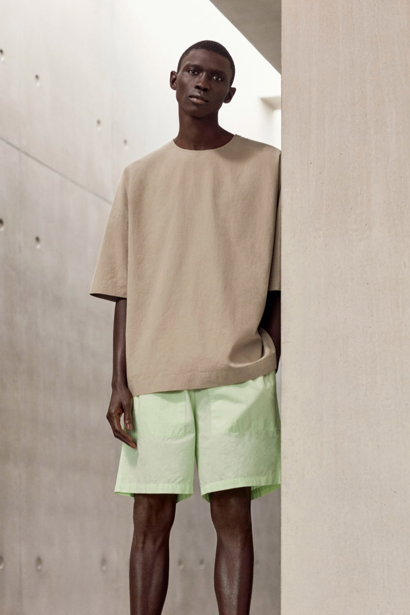 Front and center, Fernando Cabral wears an oversized cotton top and boxy shorts from COS.
