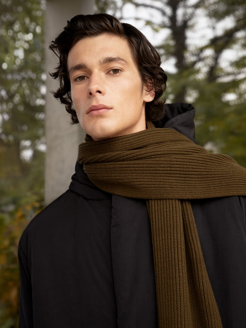 Anton Jaeger models a coat and scarf from COS.