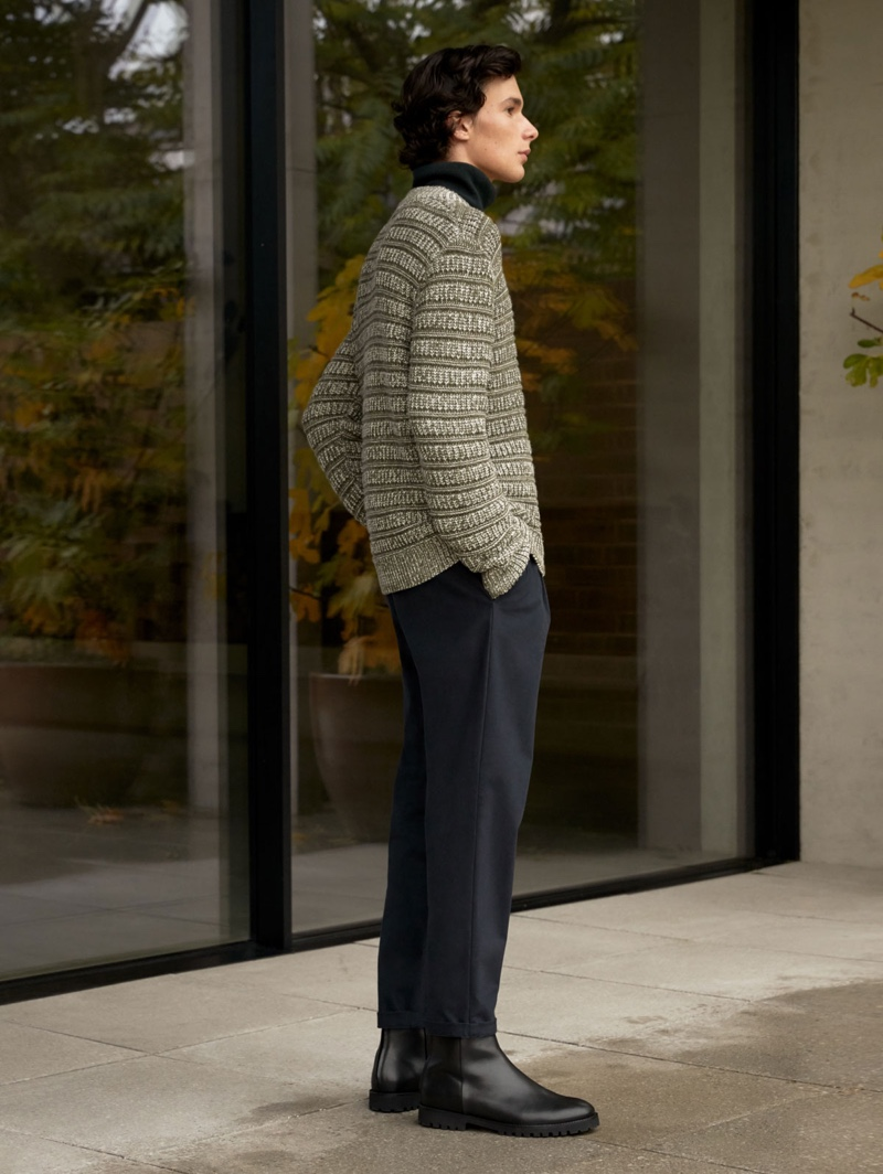 A smart vision, Anton Jaeger dons a sweater and trousers from COS.