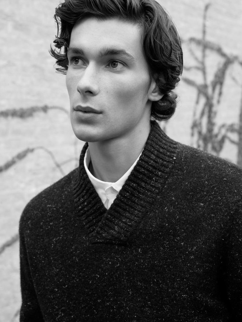 Front and center, Anton Jaeger sports a marle shawl-collar sweater from COS.