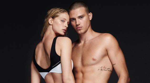 Making a case for black and white swimwear, models Abby Champion and Matthew Noszka wear Calvin Klein.