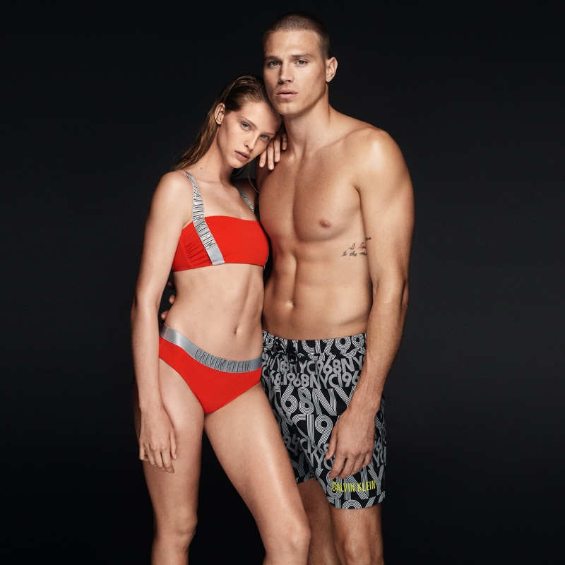 Models Abby Champion and Matthew Noszka come together in Calvin Klein swimwear.
