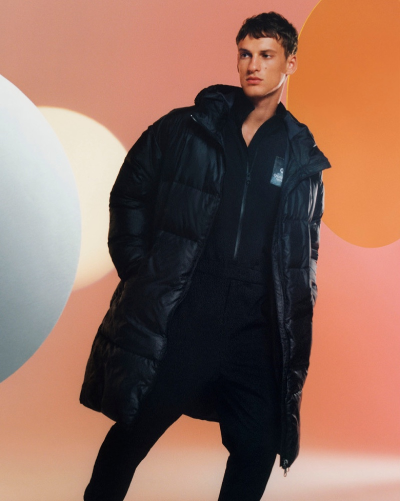 Model David Trulik sports a puffer coat for Calvin Klein's holiday 2019 campaign.