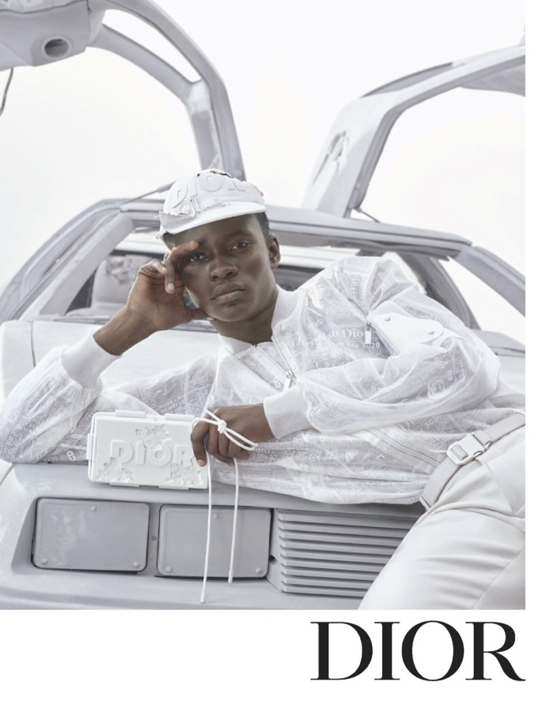 Serigne Lam sports an all-white look for Dior Men's spring-summer 2020 campaign.