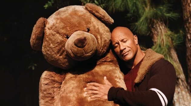 "Hugging a giant teddy bear, Dwayne ""The Rock"" Johnson sports a Dolce & Gabbana cardigan, Brioni sweater, and Double RL jeans for WSJ. magazine."