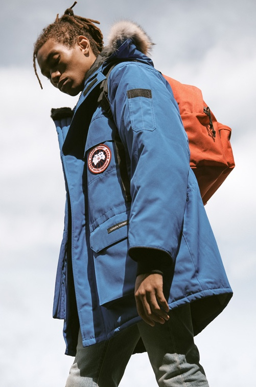 Model Seth Hill ventures outdoors in a blue Canada Goose PBI expedition parka, Levi's Red Tab skinny fit 510 denim jeans, and an Eastpak padded Pak'r backpack.