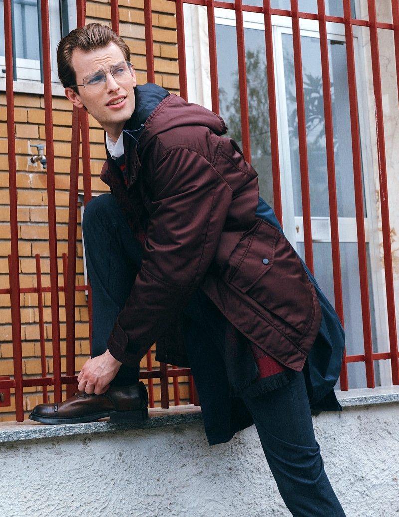 Thomas wears shirt Marsem, sweater Drumohr, foulard Daks London, pants Jacob Cohen, coat Ahirain, glasses model's own, and shoes Eleventy.