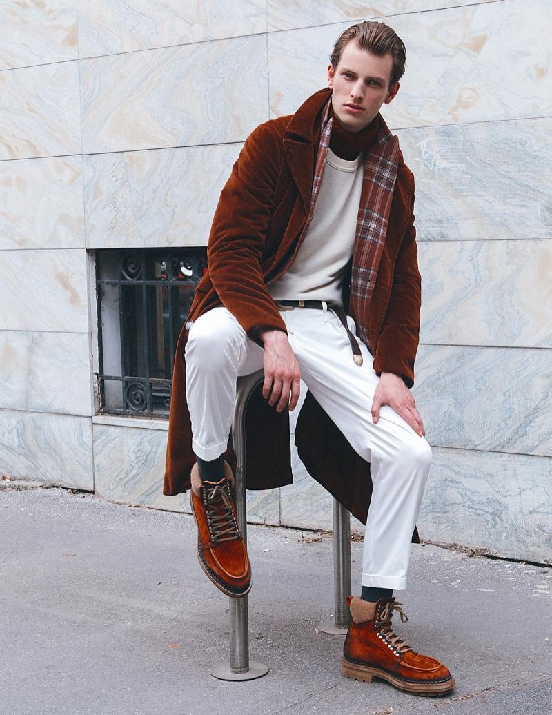 Thomas wears turtleneck Massimo Alba, sweater Siviglia, pants Marsem, jacket Corneliani, coat Massimo Alba, and boots Santoni.