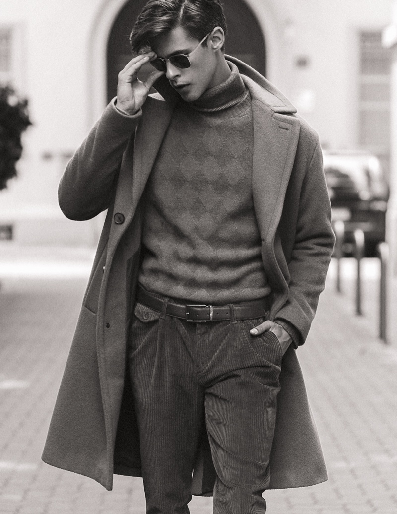 Oyvind wears turtleneck Marina Militare, sweater Cividini, pants Re-Hash, coat Hevo, belt Caporiccio, and sunglasses Maui Jim.