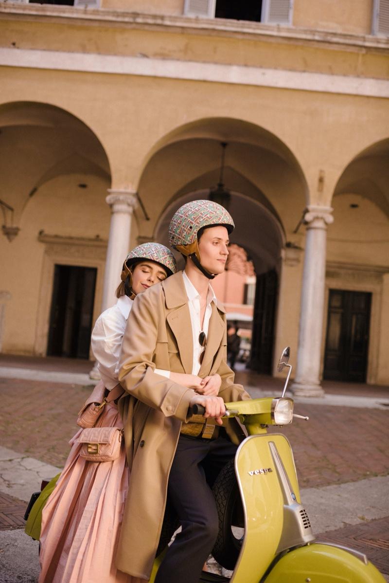 Riding a vespa, Christian Coppola and Kiernan Shipka front Fendi's Baguette Friends Forever campaign.