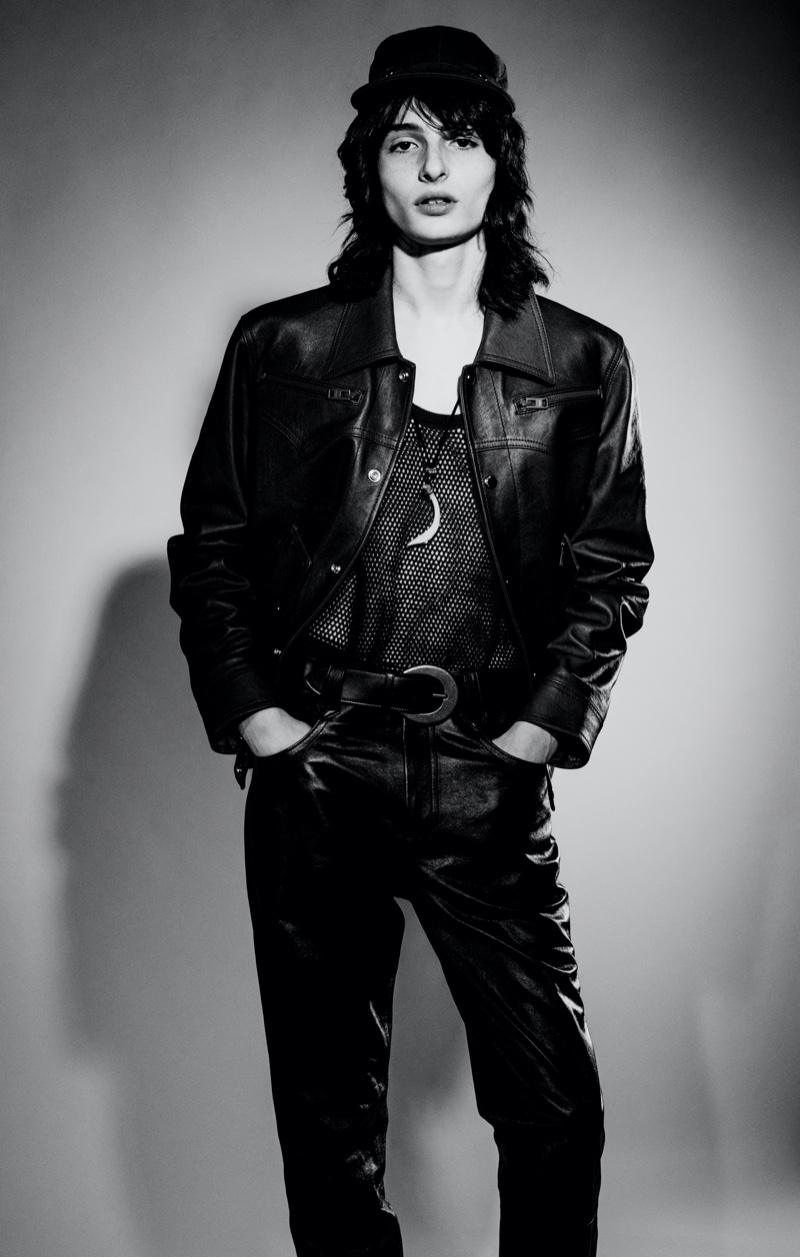 Actor Finn Wolfhard sports a leather jacket and pants with a tank from Coach 1941. He also dons a Saint Laurent belt.