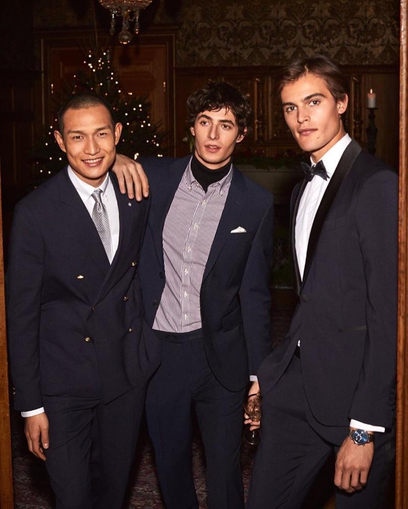 Models Zhang Wenhui, Oscar Kindelan, and Parker van Noord dress up for GANT's holiday 2019 campaign.