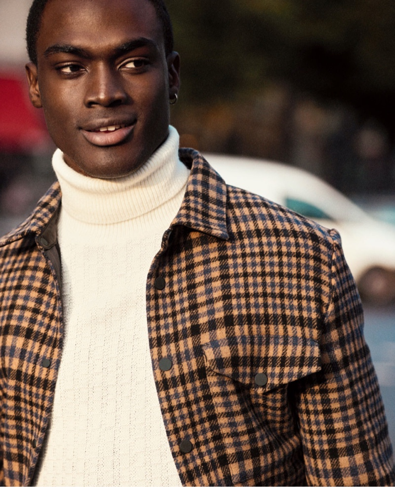 Davidson Obennebo dons a turtleneck sweater with a checked jacket by H&M.