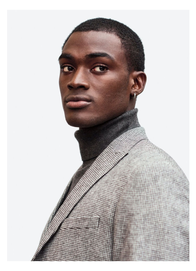 A smart vision, Davidson Obennebo wears a turtleneck with a checked suit jacket from H&M.
