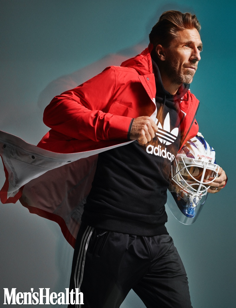 Henrik Lundqvist sports a Canada Goose seawolf jacket with an Adidas trefoil hoodie, and Y-3 STP stir-up track pants.
