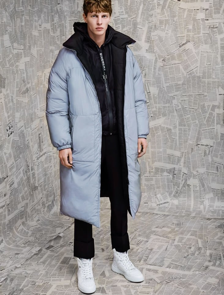Front and center, Tim Schuhmacher models a Givenchy puffer jacket with trousers and high-top sneakers.