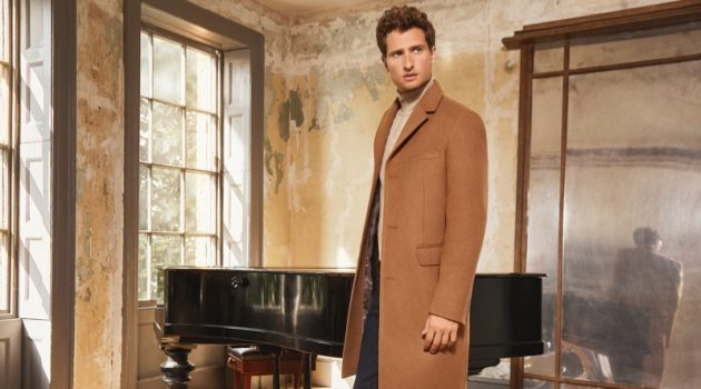 Tom Warren dons a classic camel coat for Jaeger's fall-winter 2019 campaign.