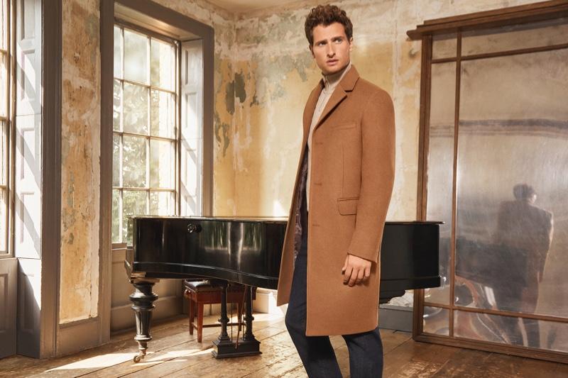 Tom Warren dons a classic camel coat for Jaeger's fall-winter 2019 campaign.