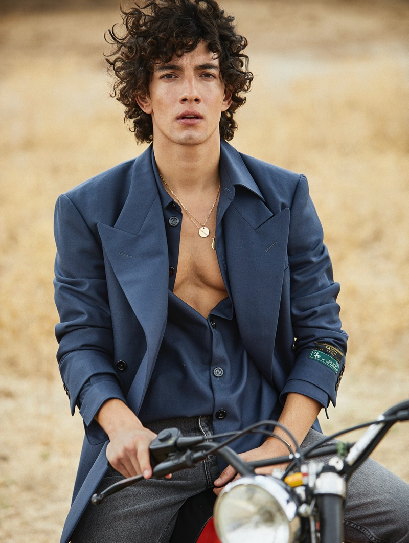 Front and center, Jorge López dons a shirt and suit jacket by Gucci with Calvin Klein jeans for GQ México shoot.