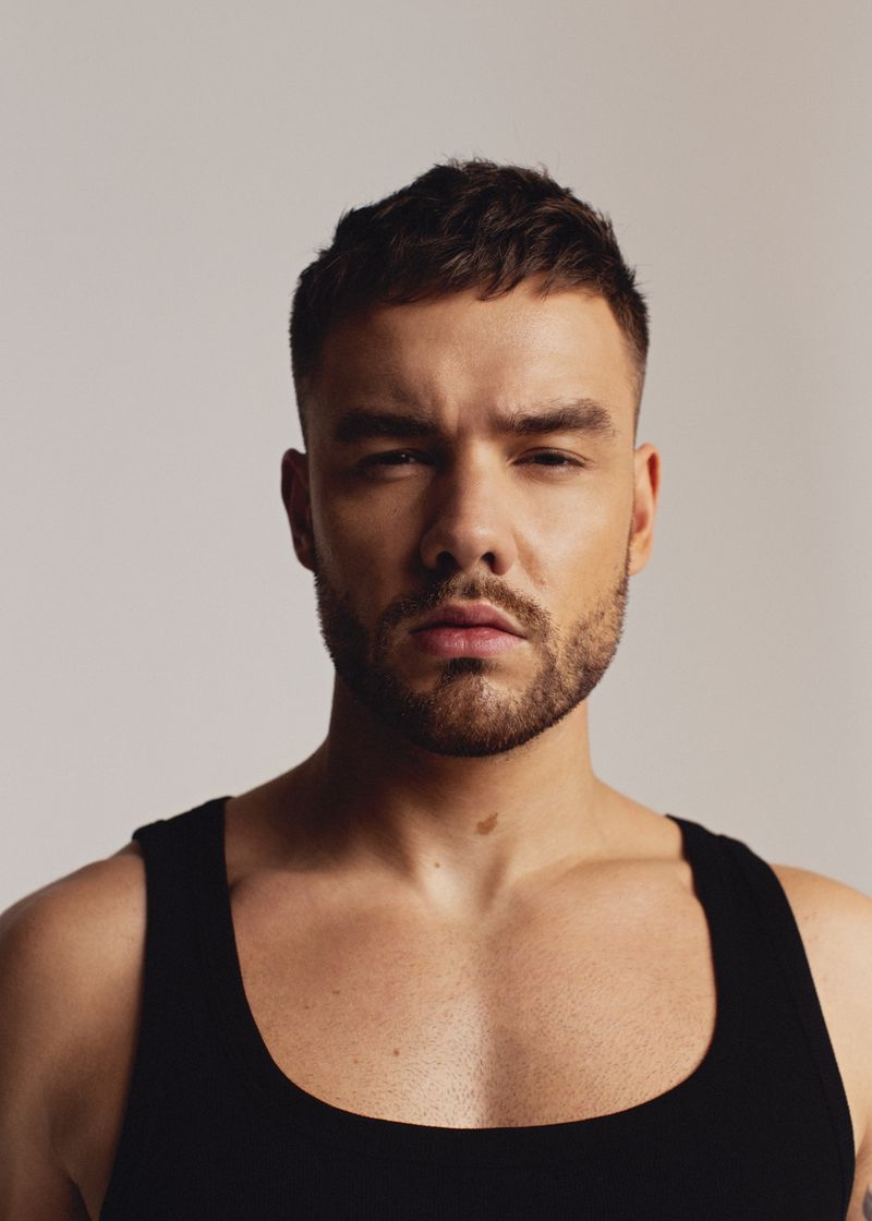 Sporting a black tank, singer Liam Payne stars in a new photo shoot for Têtu.