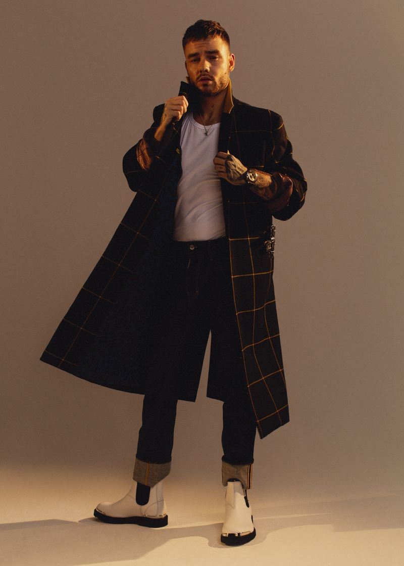 Liam Payne dons a Paul Smith coat, Versace shirt, Dsquared2 jeans, Lanvin boots, and a Rolex watch for the pages of Têtu.