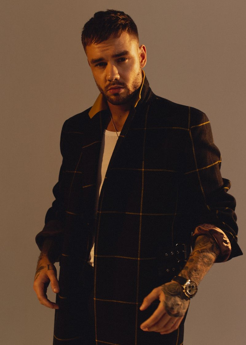 Singer Liam Payne sports a Paul Smith coat with a Versace shirt for Têtu.