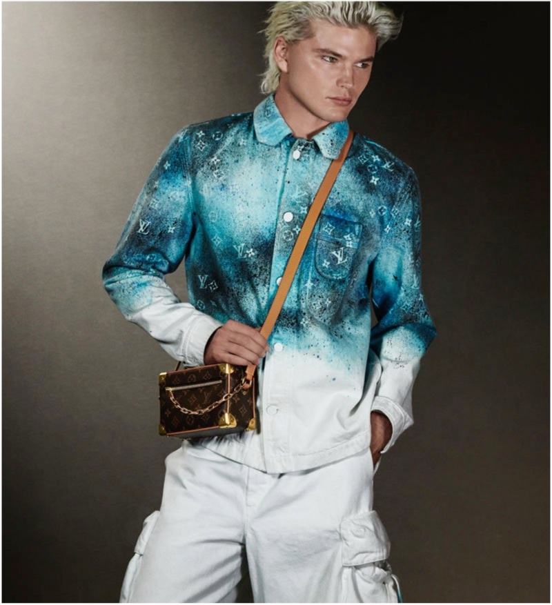 Jordan Barrett sports a workwear shirt and denim cargo pants from Louis Vuitton's pre-spring 2020 collection.