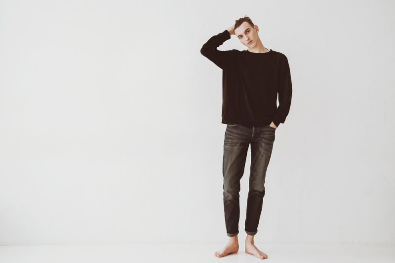 Man Black Sweater and Jeans