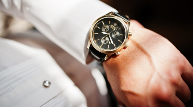 Man Looking at Rolex Watch